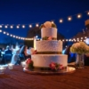 outdoor festoon lighting wedding cake